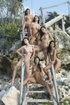 Six girls get naked together on the beach